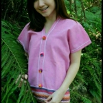 เสื้อนากา เสื้อผ้าพื้นเมือง เสื้อผ้าฝ้ายล้านนา สีชมพู แบบสวยน่ารัก คอวี แต่งกระดุม ลายผ้าพื้นเมืองสวยๆ