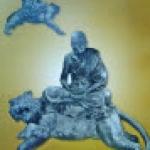 หลวงพ่อเปิ่น พิมพ์นั่งเสือ หน้าตัก ๙.๙ นิ้ว เนื้อโหะผสมรมดำ ปี ๒๕๓๕